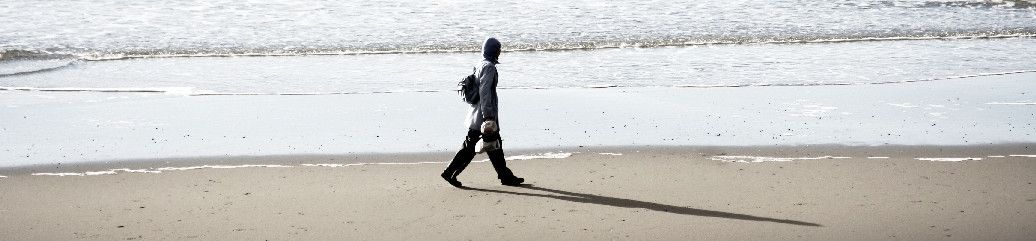 man walking on the seashore